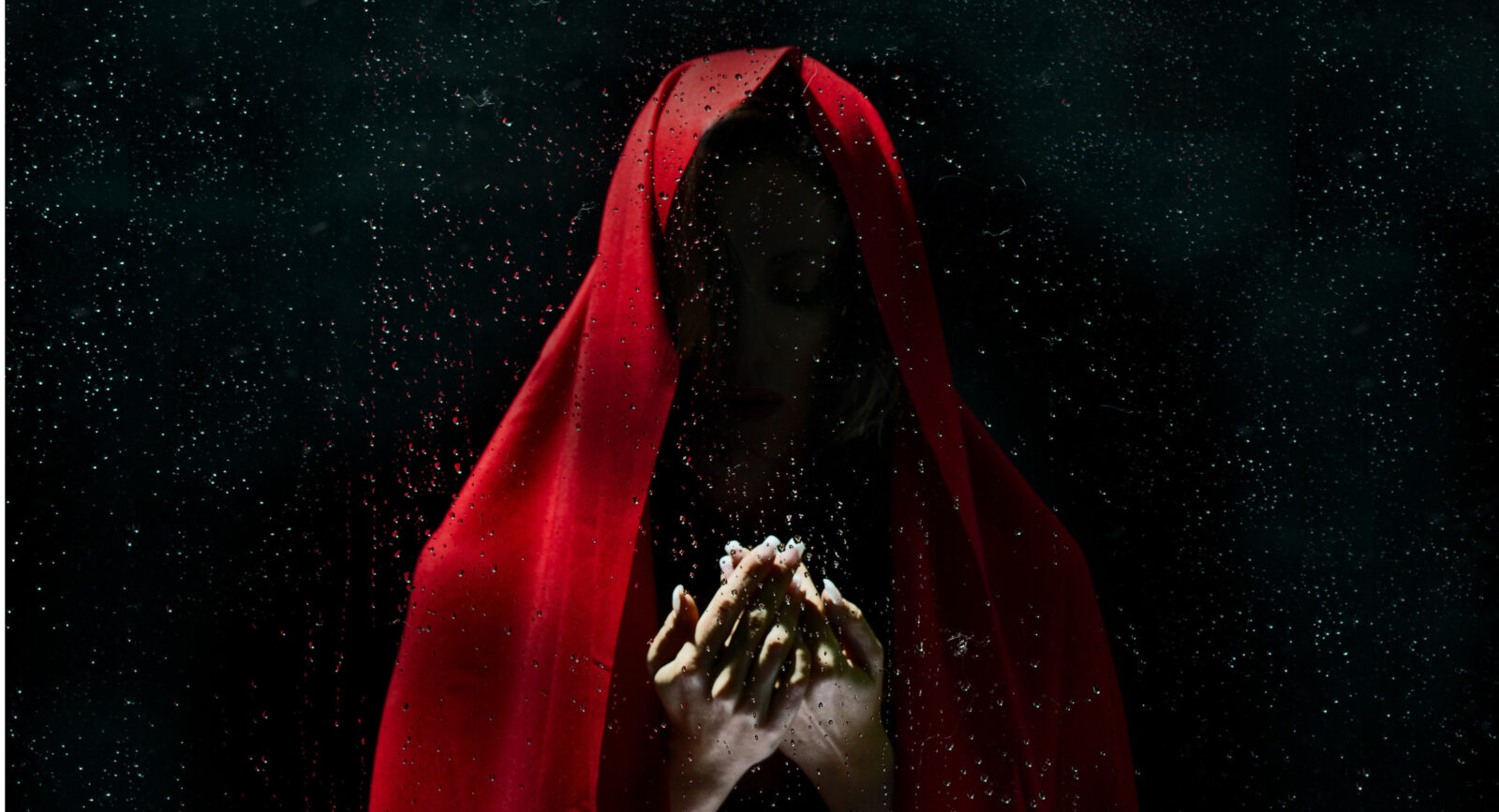 red cloaked figure
